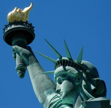"""Other statues call the liberty torch the """"Shame Flame"""" behind her back."""